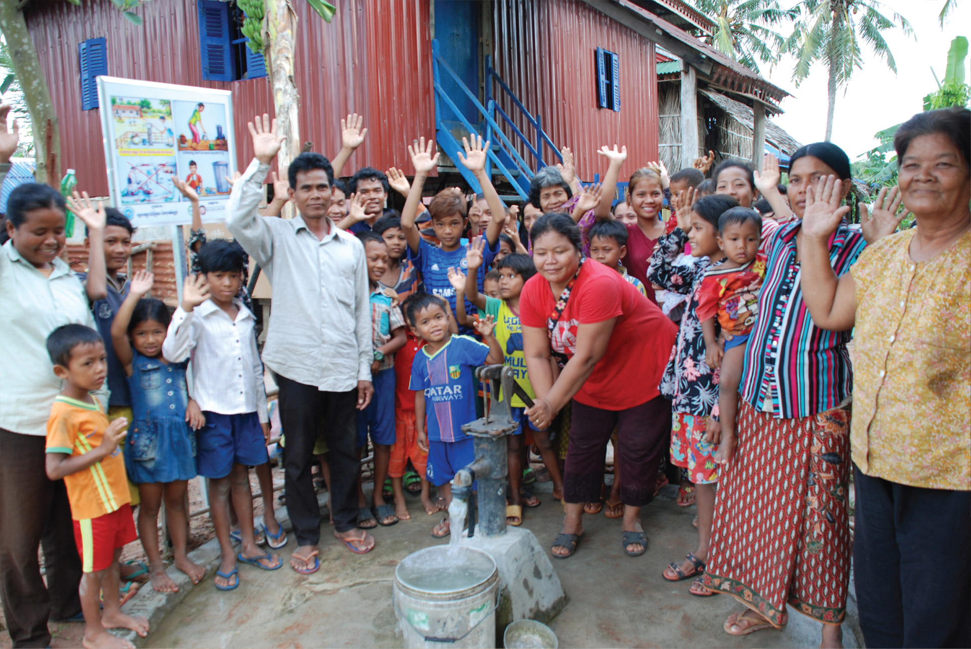 People at Water Pump: Lotus Outreach International